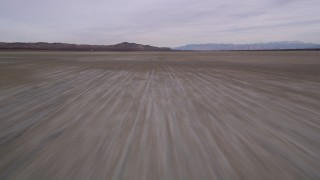 AX0006_136 - 5K stock footage aerial video of flying low over dry El Mirage Lake in the Mojave Desert, California