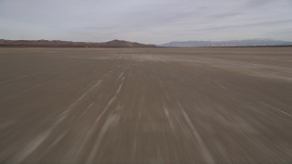 AX0006_136E - 5K stock footage aerial video of flying low over dry El Mirage Lake in the Mojave Desert, California