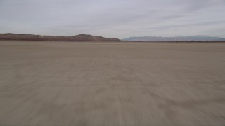 AX0006_138 - 5K stock footage aerial video of flying low over El Mirage Lake in the Mojave Desert of California