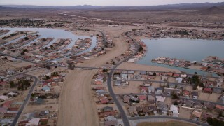 AX0006_165 - 5K stock footage aerial video approach lakefront homes in the small desert town of Helendale, California