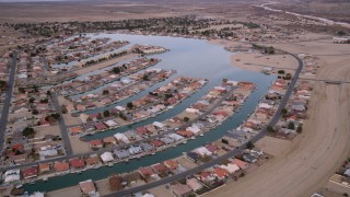 AX0006_166 - 5K stock footage aerial video orbit lakeside homes in a small desert town in Helendale, California
