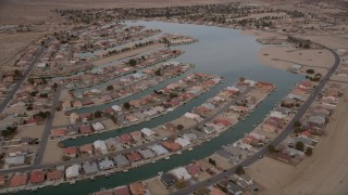 AX0006_166E - 5K stock footage aerial video orbit lakeside homes in a small desert town in Helendale, California