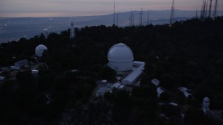 AX0008_050 - 5K stock footage aerial video orbit Mount Wilson Observatory at twilight in California