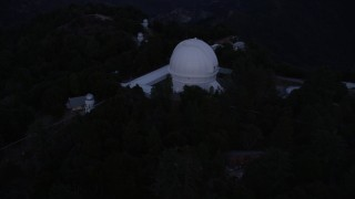 AX0008_052 - 5K stock footage aerial video orbiting around the Mount Wilson Observatory at twilight in California