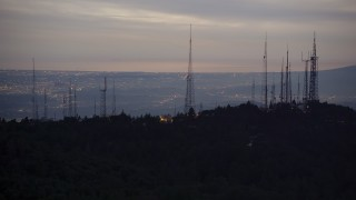 AX0008_054 - 5K stock footage aerial video of radio towers atop San Gabriel Mountains at twilight, California
