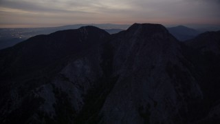 AX0008_058 - 5K stock footage aerial video of approaching peaks in the San Gabriel Mountains in California at twilight