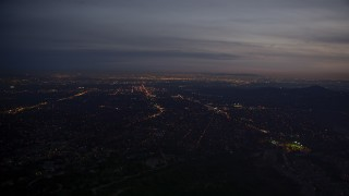 AX0008_064 - 5K stock footage aerial video of lights of San Gabriel Valley at twilight, California