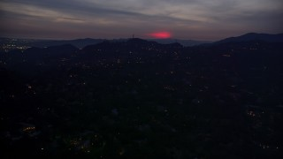 AX0008_070 - 5K stock footage aerial video of a red glow in clouds above hillside homes in La Cañada Flintridge at night, California