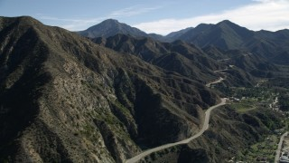 AX0009_013E - 5K stock footage aerial video of Big Tujunga Canyon Road in the San Gabriel Mountains, California