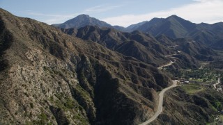 AX0009_014 - 5K stock footage aerial video of a mountain road and ridge in the San Gabriel Mountains, California