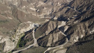 AX0009_015 - 5K stock footage aerial video approach Big Tujunga Dam and Reservoir in the mountains, California