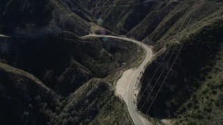 AX0009_019 - 5K stock footage aerial video of a bend of a road through the San Gabriel Mountains, California