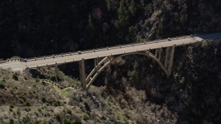 AX0009_024 - 5K stock footage aerial video orbit small bridge in San Gabriel Mountains, California
