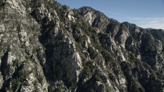 AX0009_031 - 5K stock footage aerial video of rocky slopes in the San Gabriel Mountains of California