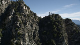 AX0009_032 - 5K stock footage aerial video approach and fly over a rocky ridge in the San Gabriel Mountains, California