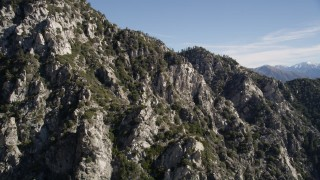 AX0009_033 - 5K stock footage aerial video approach jagged and rocky slopes in the San Gabriel Mountains, California