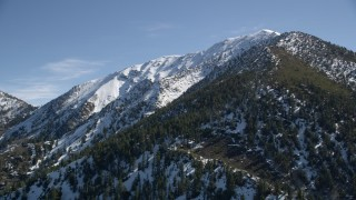 AX0009_057 - 5K stock footage aerial video of a snowy mountain peak in the San Gabriel Mountains, California