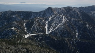 AX0009_065 - 5K stock footage aerial video of Mount Baldy Ski Lifts Skit Resort in winter, California