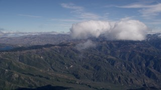 AX0009_080 - 5K stock footage aerial video of flying through a cloud to reveal the San Bernardino Mountains, California