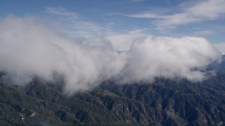 AX0009_082 - 5K stock footage aerial video of a cloud moving over the San Bernardino Mountains, California