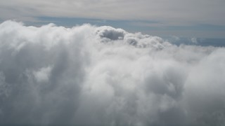 AX0009_091E - 5K stock footage aerial video fly over thick cloud cover over San Bernardino County, California