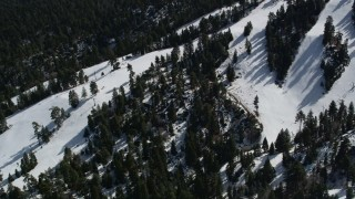 AX0009_131 - 5K stock footage aerial video orbit steep, snowy slopes at the Snow Summit Ski Resort in winter, California