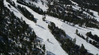 AX0009_133 - 5K stock footage aerial video orbit skiers on slopes at the winter ski resort of Snow Summit, California
