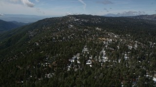 AX0009_137 - 5K stock footage aerial video of patches of snow and evergreen forest in the San Bernardino Mountains, California