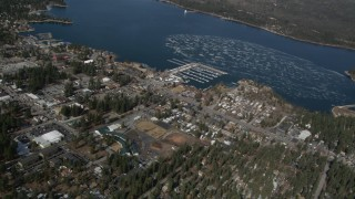 AX0009_138 - 5K stock footage aerial video orbit a small lakeside town on Big Bear Lake in winter, California