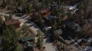 AX0010_011 - 5K stock footage aerial video orbit rural homes with patches of snow at Big Bear Lake, California