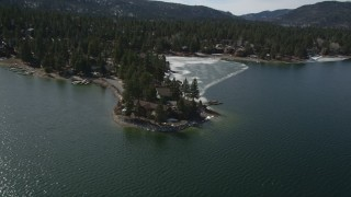 AX0010_018 - 5K stock footage aerial video orbit lakeside homes by an ice patch at Big Bear Lake, California