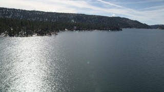 AX0010_023 - 5K stock footage aerial video approach waterfront homes on the shore of Big Bear Lake, California