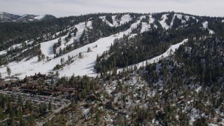 AX0010_039 - 5K stock footage aerial video tilt to reveal and approach Snow Summit Ski Resort in winter, California