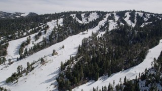 AX0010_040 - 5K stock footage aerial video approach snowy slopes of Snow Summit Ski Resort in winter, California