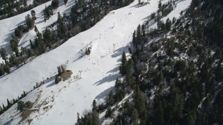 AX0010_041 - 5K stock footage aerial video of skiers and lift at the Snow Summit Ski Resort in winter, California