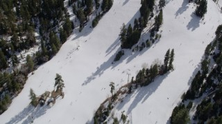 AX0010_042 - 5K stock footage aerial video fly over skiers on the slopes of Snow Summit in winter, California