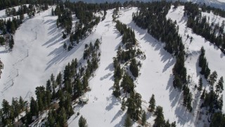 AX0010_043 - 5K stock footage aerial video fly over skiers and lifts at Snow Summit in winter, California
