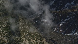 AX0010_069 - 5K stock footage aerial video bird's eye view of snow in steep canyon in the San Jacinto Mountains, California