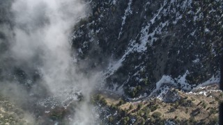 AX0010_070 - 5K stock footage aerial video of bird's eye view of snowy slope in the San Jacinto Mountains, California