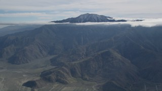 AX0010_083 - 5K stock footage aerial video approach peak with cloud halo in the San Jacinto Mountains, California