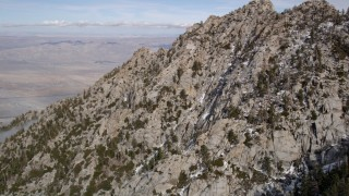 AX0010_098 - 5K stock footage aerial video fly over mountain slopes with small patches of snow in the San Jacinto Mountains, California