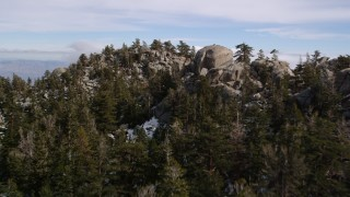 AX0010_104 - 5K stock footage aerial video fly over rocky slopes with small patches of snow in the San Jacinto Mountains, California
