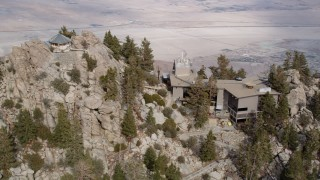 AX0010_107 - 5K stock footage aerial video orbiting the mountaintop station of an aerial tramway in the San Jacinto Mountains, California
