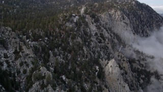 AX0010_111 - 5K stock footage aerial video tilt to reveal and approach a tram station in the San Jacinto Mountains, California
