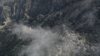 AX0010_114 - 5K stock footage aerial video of bird's eye view of a gondola heading up the San Jacinto Mountains, California