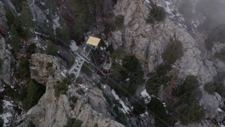 AX0010_115 - 5K stock footage aerial video of tracking gondola heading up the San Jacinto Mountains, California