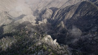 AX0010_122 - 5K stock footage aerial video of bird's eye view of jagged slopes and ground base of tramway in the San Jacinto Mountains, California