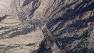 AX0010_124 - 5K stock footage aerial video of bird's eye view of the ground station of the aerial tramway in the San Jacinto Mountains, California