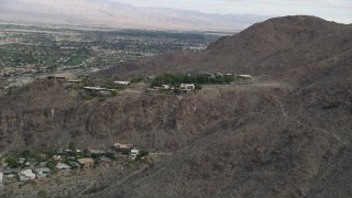 AX0010_135 - 5K stock footage aerial video approach hilltop mansions in West Palm Springs, California