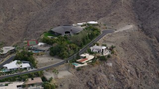 AX0010_136 - 5K stock footage aerial video orbiting a group of hilltop mansions in West Palm Springs, California